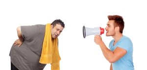 Fat men and his personal trainer with a megaphone isolated on a